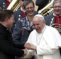 Papa Francesco saluta un sacerdote e membri della banda musicale Davos al termine dell'udienza generale del mercoledi' in Piazza San Pietro, Citta' del Vaticano, 1 maggio 2019.<br /> Pope Francis greets a priest and members of the Davos brass band at the end of his weekly general audience in St. Peter's Square at the Vatican, on May 1, 2019.<br /> UPDATE IMAGES PRESS/Isabella Bonotto<br /> <br /> STRICTLY ONLY FOR EDITORIAL USE