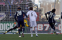 New England Revolution midfielder Shalrie Joseph (21) scores on penalty kick. In a Major League Soccer (MLS) match, the New England Revolution defeated DC United, 2-1, at Gillette Stadium on March 26, 2011.