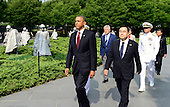 United States President Barack Obama arrives to lay a wreath prior to delivering remarks marking the 60th Anniversary of the Korean War Armistice at the Korean War Veterans Memorial in Washington, D.C. on Saturday, July 27, 2013.<br /> Credit: Ron Sachs / Pool via CNP
