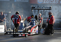 Jun. 15, 2012; Bristol, TN, USA: NHRA crew members for top fuel dragster driver Bruce Litton during qualifying for the Thunder Valley Nationals at Bristol Dragway. Mandatory Credit: Mark J. Rebilas-