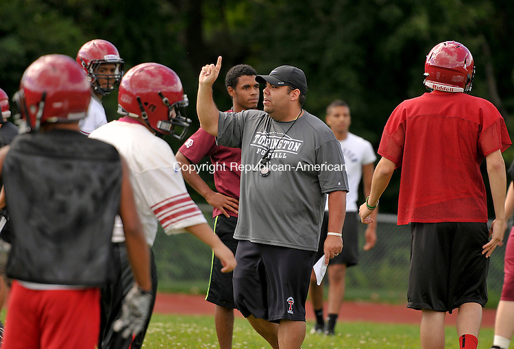 TORRINGTON, CT 14 AUGUST 2013--081413JS01-Torrington's new football coach Gaitan Rodriguez, center, gives instructions to his players during the first day of practice Wednesday at Torrington High School. <br /> Jim Shannon Republican American