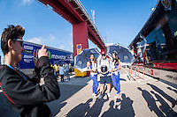 VALENCIA, SPAIN - NOVEMBER 8: Fans shoot a photo with yamaha paddok girls during Valencia MotoGP 2015 at Ricardo Tormo Circuit on November 8, 2015 in Valencia, Spain