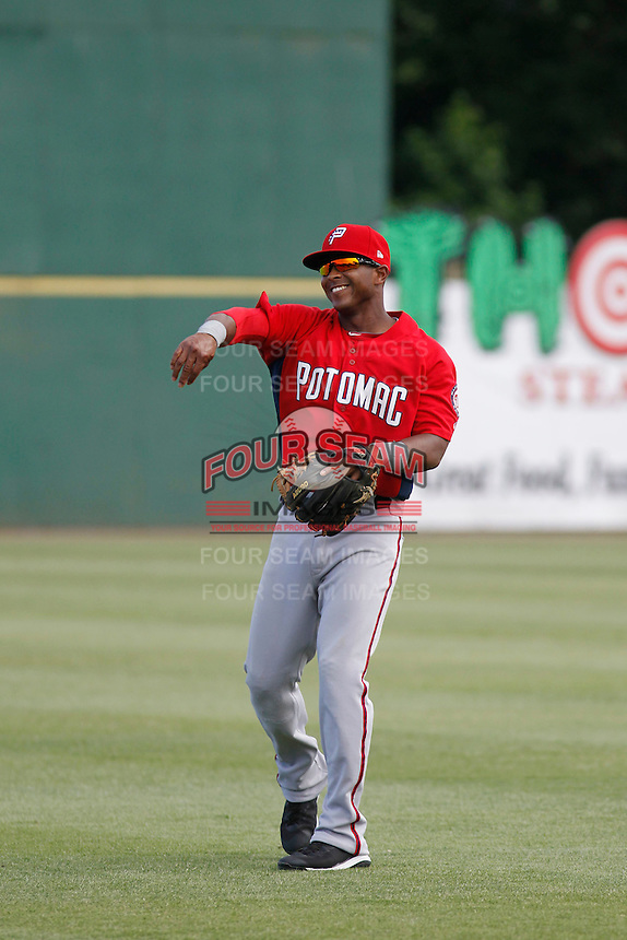 Potomac Nationals infielder Khayyan Norfolk (15) throwing in the outfield before a game against the Myrtle Beach Pelicans at Ticketreturn.com Field at Pelicans Ballpark on May 25, 2015 in Myrtle Beach, South Carolina.  Myrtle Beach defeated Potomac 3-0. (Robert Gurganus/Four Seam Images)