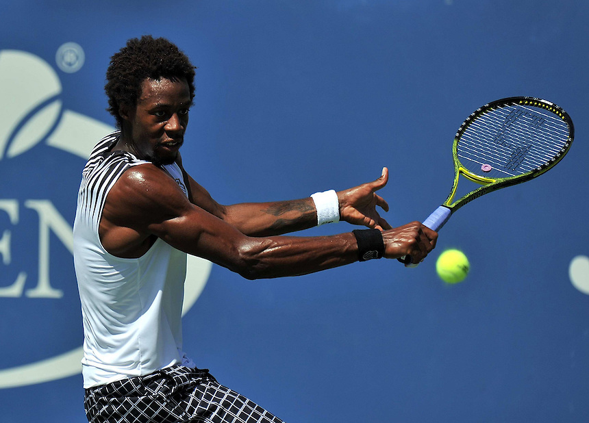 Gael Monfils (FRA) the No 17 seed in action against Richard Gasquet (FRA) in the Men's Singles - 4th Round at Louis Armstrong Stadium..