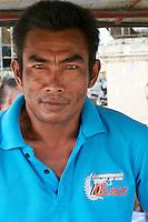 Phnom Penh, Cambodia. Man with Glock pistol t-shirt.
