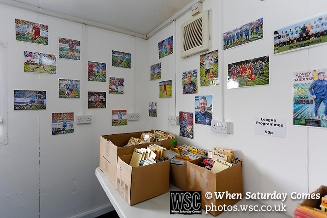 Programmes and player pictures in the Ossett United club shop. Yorkshire v Parishes of Jersey, CONIFA Heritage Cup, Ingfield Stadium, Ossett. Yorkshire's first competitive game. The Yorkshire International Football Association was formed in 2017 and accepted by CONIFA in 2018. Their first competative fixture saw them host Parishes of Jersey in the Heritage Cup at Ingfield stadium in Ossett. Yorkshire won 1-0 with a 93 minute goal in front of 521 people. Photo by Paul Thompson