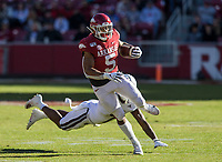 NWA Democrat-Gazette/BEN GOFF @NWABENGOFF<br /> Rakeem Boyd, Arkansas running back, breaks the tackle of Marcus Murphy, Mississippi State free safety, on a 52 yard touchdown run in the second quarter Saturday, Nov. 2, 2019, at Reynolds Razorback Stadium in Fayetteville.