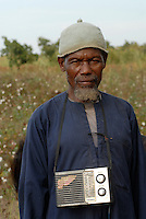 MALI , village Faragouaran, cotton farmer with radio / MALI, Baumwoll Farmer mit Radio aus Dorf Faragouaran