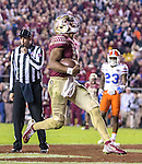 Florida State quarterback Deondre Francois reacts to scoring a touchdown against Florida in the fourth quarter of an NCAA college football game in Tallahassee, Fla., Saturday, Nov. 26, 2016. Florida State defeated Florida 31-13. (AP Photo/Mark Wallheiser)