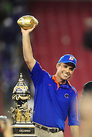 Jan. 4, 2010; Glendale, AZ, USA; Boise State Broncos head coach Chris Petersen celebrates with the trophy following the game against the TCU Horned Frogs in the 2010 Fiesta Bowl at University of Phoenix Stadium. Boise State defeated TCU 17-10. Mandatory Credit: Mark J. Rebilas-
