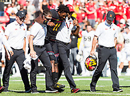 College Park, MD - SEPT 23, 2017: Maryland Terrapins quarterback Kasim Hill (11) is helped off the field after injuring his leg early in the first quarter during game between Maryland and UCF at Capital One Field at Maryland Stadium in College Park, MD. (Photo by Phil Peters/Media Images International)