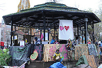 November 23, 2011, Toronto Police deployed in significant numbers this morning, beginning the process of evicting the Occupy Toronto tent camp from St. James Park.  Here, a number of unidentified protest supporters hold their ground at the park bandshell.