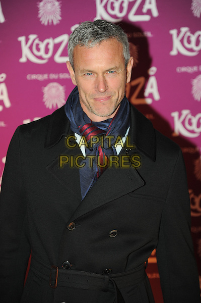 Mark Foster.Opening night of  the Cirque du Soleil's 'Kooza' at the Royal Albert Hall - Arrivals.London, England..January 8th, 2013.half length jacket black blue red scarf .CAP/CAS.©Bob Cass/Capital Pictures.
