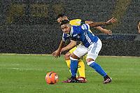 BOGOTA - COLOMBIA - 12 - 02 - 2017: Cristian Arango (Der.) jugador de Millonarios disputa el balón con Yulian Anchico (Izq.) jugador de Atletico Bucaramanga, durante partido de la fecha 3 entre Millonarios y Atletico Bucaramanga, de la Liga Aguila I-2017, jugado en el estadio Nemesio Camacho El Campin de la ciudad de Bogota.  / Cristian Arango (R) player of Millonarios vies for the ball with con Yulian Anchico (L) player of Atletico Bucaramanga, during a match between Millonarios and Atletico Bucaramanga, for the date 3 of the Liga Aguila I-2017 played at the Nemesio Camacho El Campin Stadium in Bogota city, Photo: VizzorImage / Luis Ramirez / Staff.