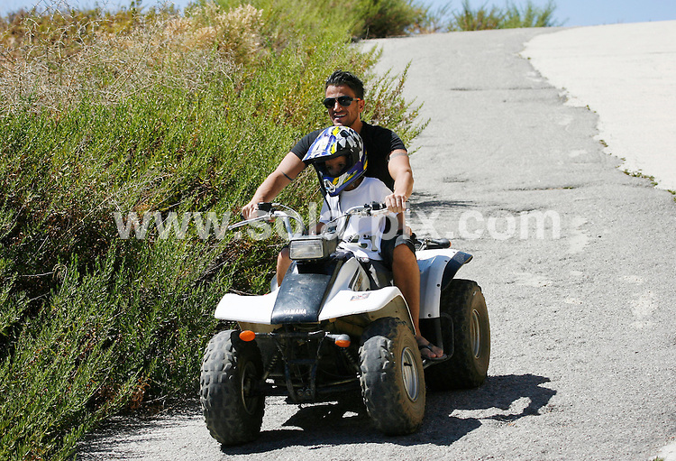 **ALL ROUND  PICTURES FROM SOLARPIX.COM**.**WORLDWIDE SYNDICATION RIGHTS**.Peter Andre goes quad biking with his children Princess & Junior and his brother Michael in the hills above Marbella Spain..JOB REF:  9877    AB1       DATE:  04.09.09.**MUST CREDIT SOLARPIX.COM OR DOUBLE FEE WILL BE CHARGED**.**MUST NOTIFY SOLARPIX OF ONLINE USAGE**.**CALL US ON: +34 952 811 768 or LOW RATE FROM UK 0844 617 7637**
