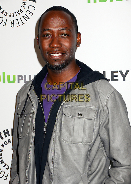 "Lamorne Morris.The Paley Center for Media Honors ""New Girl"" at PaleyFest 2012 held at the Saban Theatre, Beverly HIlls, California, USA..March 5th, 2012.half length black grey gray leather jacket .CAP/ADM/BT.©Birdie Thompson/AdMedia/Capital Pictures."