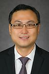 Ming Zhou, Associate Professor, School of Accountancy, Driehaus College of Business , DePaul University, is pictured in a studio portrait Sept. 28, 2017. (DePaul University/Jeff Carrion)
