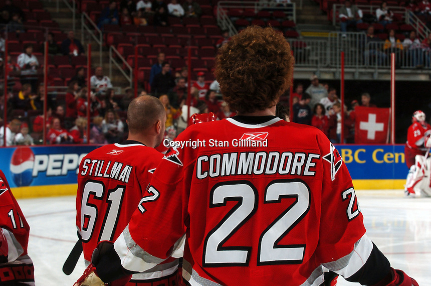 Carolina Hurricanes' Cory Stillman (61) and Mike Commodore (22) display a disparity in hairstyles during warmups prior to their game with the Florida Panthers Friday, March 3, 2006 at the RBC Center in Raleigh, NC. Carolina won 5-2.