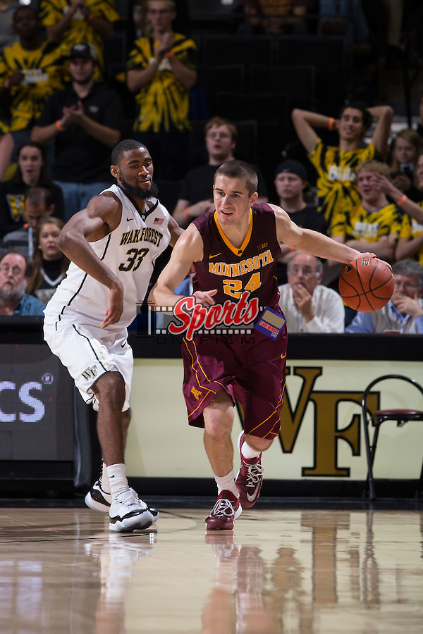 Joey King (24) of the Minnesota Golden Gophers is guarded by Aaron Rountree III (33) of the Wake Forest Demon Deacons during second half action at the LJVM Coliseum on December 2, 2014 in Winston-Salem, North Carolina.  The Golden Gophers defeated the Demon Deacons 84-69. (Brian Westerholt/Sports On Film)