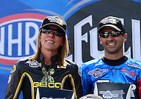 Sept. 14, 2012; Concord, NC, USA: NHRA pro stock motorcycle rider Karen Stoffer (left) with Scotty Pollacheck during qualifying for the O'Reilly Auto Parts Nationals at zMax Dragway. Mandatory Credit: Mark J. Rebilas-