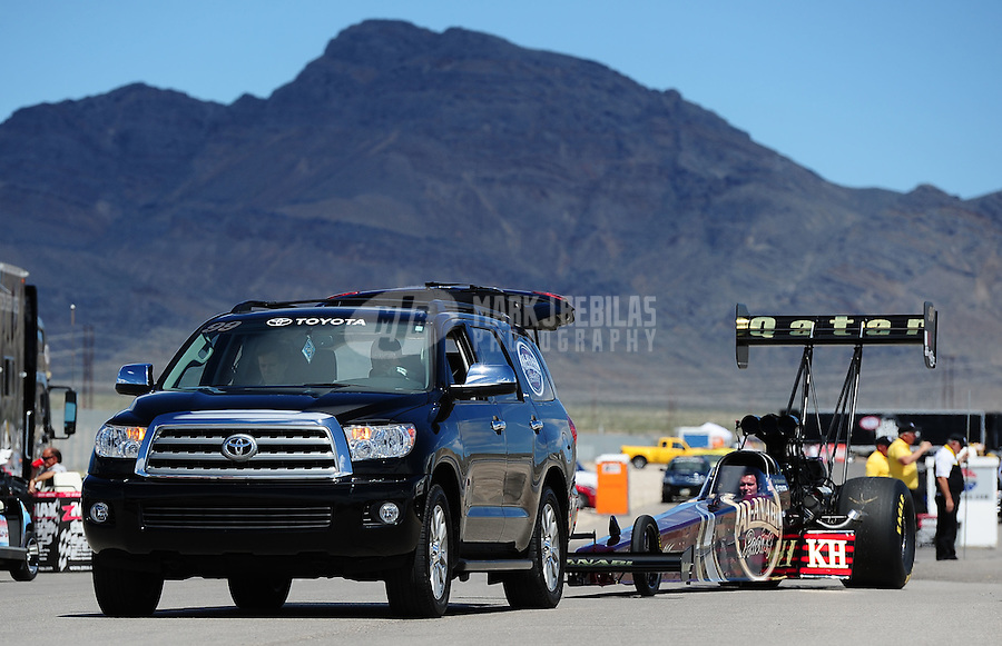 Apr. 2, 2011; Las Vegas, NV, USA: The car of NHRA top fuel dragster driver Del Worsham is towed back to the pits during qualifying for the Summitracing.com Nationals at The Strip in Las Vegas. Mandatory Credit: Mark J. Rebilas-