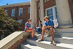 Senior elementary education majors Cassie Carlton, left, Maggie Cates and Ty Vanderford work on a group project on the steps of Guyton Hall. Photo by Kevin Bain/Ole Miss Communications