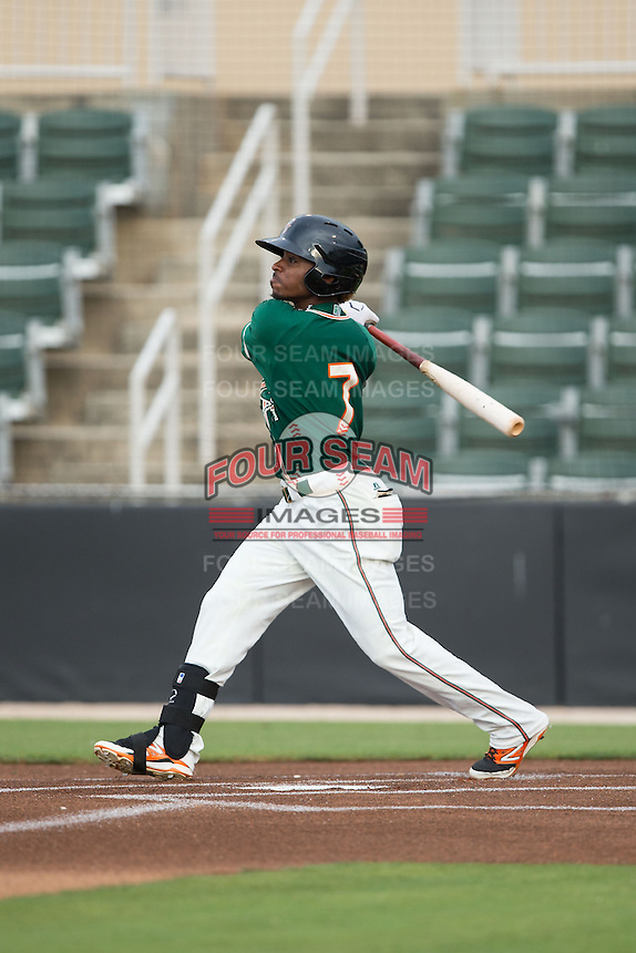 Mason Davis (7) of the Greensboro Grasshoppers follows through on his swing against the Kannapolis Intimidators at CMC-Northeast Stadium on June 9, 2015 in Kannapolis, North Carolina.  The Intimidators defeated the Grasshoppers 6-4.  (Brian Westerholt/Four Seam Images)