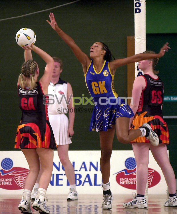 Pix: Matthew Lewis/SWpix.com. Netball. Super Cup 2003. Aston Villa Sports Centre. 17/05/2003...COPYRIGHT PICTURE>>SIMON WILKINSON>>01943 436649>>..Team Bath's Geva Mentor looks to stop Northern Flames Heather Clarke's shot on goal.