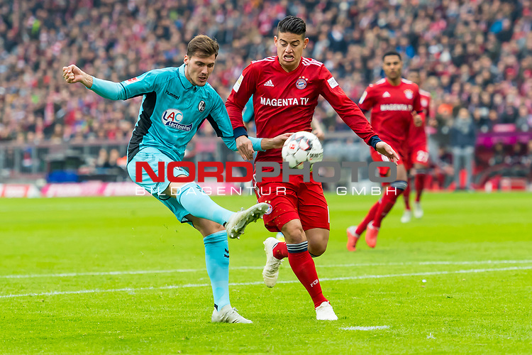 03.11.2018, Allianz Arena, Muenchen, GER, 1.FBL,  FC Bayern Muenchen vs. SC Freiburg, DFL regulations prohibit any use of photographs as image sequences and/or quasi-video, im Bild Pascal Stenzel (Freiburg #15) im kampf mit James Rodriguez (FCB #11) <br /> <br />  Foto © nordphoto / Straubmeier