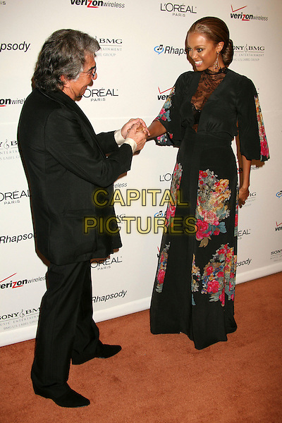 ROBERTO CAVALLI & TYRA BANKS.Clive Davis 2007 Pre-Grammy Awards Party at the Beverly Hilton Hotel, Beverly Hills, USA..February 10th, 2007.full length black dress lace pink gold floral print shaking suit hands .CAP/ADM/BP.©Byron Purvis/AdMedia/Capital Pictures