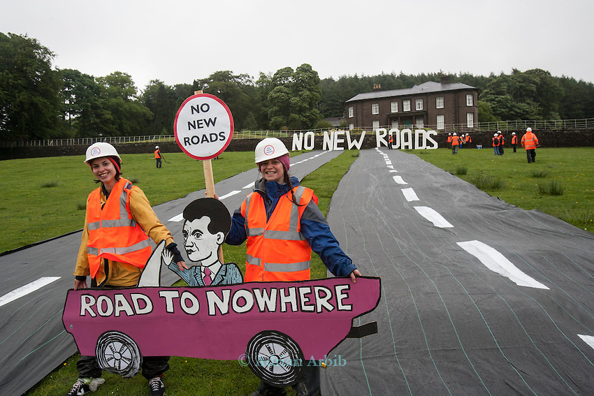 Natalie Hynde Daughter of  Chrissie Hynde and Ray Davies and  Gabriele  join 20 activists dressed in roadbuilders' high viz clothing rolling out a fake road in the field  immediately below Crag Hall, Cheshire in who's  grounds  the Chancellor  of the  exchequer George Osborne has a residence .  <br /> The protest was made to highlight the expected  release of money for roadbuilding schemes throughout  the UK in the imminent spending  reivew on Wednesday 26th June