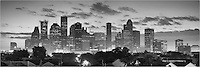 Low clouds hang over the skyscrapers of downtown Houston in this panorama taken on a warm morning. The skyline was beginning to come to life and the sun was only minutes away from making its appearance. This image was converted into black and white because I liked the contrast.