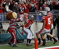 Brutus Buckeye celebrates Ohio State Buckeyes wide receiver Devin Smith's (9) touchdown catch with wide receiver Evan Spencer (6) and wide receiver Michael Thomas (3) during the second quarter of the NCAA football game at Ohio Stadium on Nov. 1, 2014. (Adam Cairns / The Columbus Dispatch)
