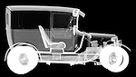 X-ray image of an antique delivery truck (white on black) by Jim Wehtje, specialist in x-ray art and design images.