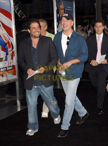 "BRETT RATNER & BRUCE WILLIS.World Premiere of ""Talladega Nights:The Ballad of Ricky Bobby"" held at The Grauman's Chinese Theatre in Hollywood, California, USA..July 26th, 2006.Ref: DVS.full length jeans denim black suit jacket blue shirt walking.www.capitalpictures.com.sales@capitalpictures.com.©Debbie VanStory/Capital Pictures"