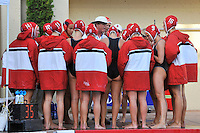 10 May 2008:  Stanford Cardinal head coach John Tanner (white shirt) and assistant coach Susan Ortwein (white cap) talk with Emily Clopp (14), Megan Nesland (8), Koree Blyleven (10), Jenna Gunderson (11), Amber Oland (1), Kim Krueger (7), Chelsea Smith-Carmichael (6), Kelsey Holshouser (4), Jacquelyn Gauthier (3), Kira Hillman (9), Alex Koran (16), and teammates during the semi-final match of the 2008 NCAA women's water polo championships at the Avery Aquatic Center in Stanford, CA.  USC defeated Stanford 10-6, to move on to the championship match against UCLA.