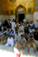 Iraqis pray at the Muqmadia mosque on friday June 4 2004 in Iraq