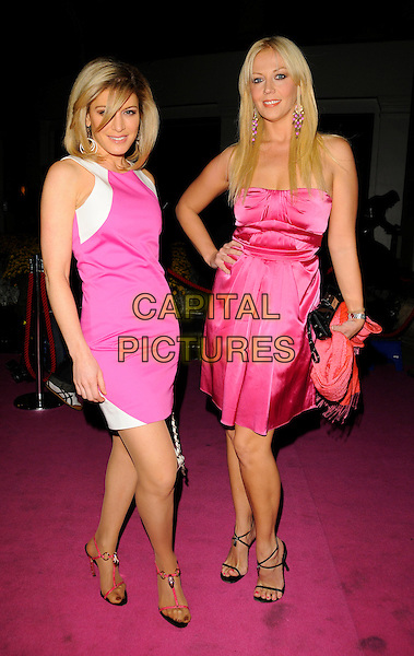 HOFIT GOLAN & LIZ FULLER .At the Breast Cancer Care 2008 Fashion Show, Grosvenor House Hotel, London, England, UK, October 1st 2008..full length pink dress dresses strapless white hand on hip clutch bag sandals shoes .CAP/CAN.©Can Nguyen/Capital Pictures