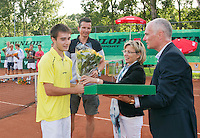 August 9, 2014, Netherlands, Rotterdam, TV Victoria, Tennis, National Junior Championships, NJK,  Prize giving, Richard Krajicek with Guy den Heijer, winner boys 18 years receives the trophy and flowers from Petra Hermans-Verloop and Chris van Gennip<br /> Photo: Tennisimages/Henk Koster