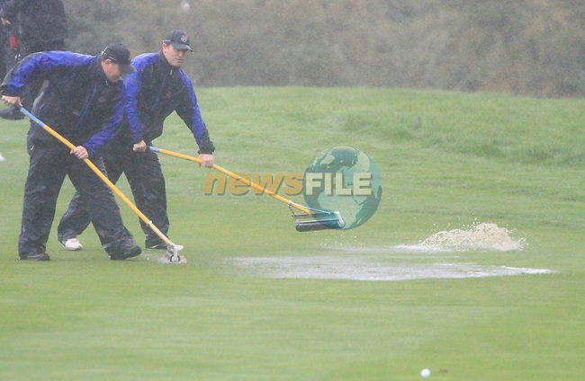 Greenkeepers try to clear the fairways on the 5th hole in the torrential rain in the morning Fourball Match 2  during Day 1 of the The 2010 Ryder Cup at the Celtic Manor, Newport, Wales, 29th September 2010..(Picture Eoin Clarke/www.golffile.ie)
