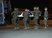 A United States Marine Corps carry team participates in the Dignified Transfer of the transfer case containing the remains of United States Marine Corps Staff Sergeant Christopher A. Slutman at Dover Air Force Base in Dover, Delaware on April 11, 2019.  he died as the result of a road-side bomb in Afghanistan on April 8, 2019.  Staff Sergeant Slutman, a decorated 15 year veteran of the Fire Department of New York (FDNY), was married and had three children.<br /> Credit: Ron Sachs / CNP<br /> (RESTRICTION: NO New York or New Jersey Newspapers or newspapers within a 75 mile radius of New York City)