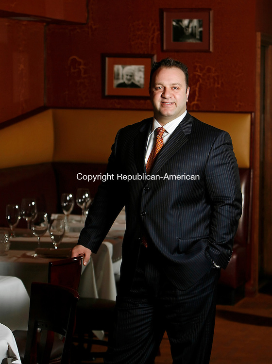 WATERBURY, CT, 02/04/08- 020409BZ06- Vasilias Kaloidis, owner/partner, poses in the dining room of Vintage Restaurant on Bank Street in Waterbury Wednesday. <br /> Jamison C. Bazinet Republican-American