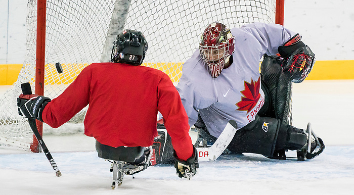 PyeongChang 8/3/2018 - Corbin Watson, of Kingsville, ON, and Brad Bowden, of Orton, ON, as Canada's sledge hockey team practices ahead of the start of competition at the Gangneung practice venue during the 2018 Winter Paralympic Games in Pyeongchang, Korea. Photo: Dave Holland/Canadian Paralympic Committee