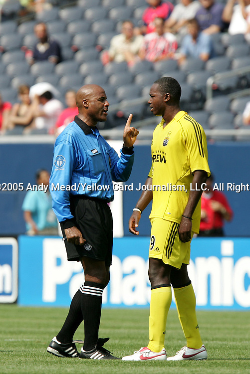 16 July 2005: Referee Richard Heron (l) issues a warning to Knox Cameron (r). The Chicago Fire and Columbus Crew tied 1-1 at Soldier Field in Chicago, Illinois in a regular season Major League Soccer game.