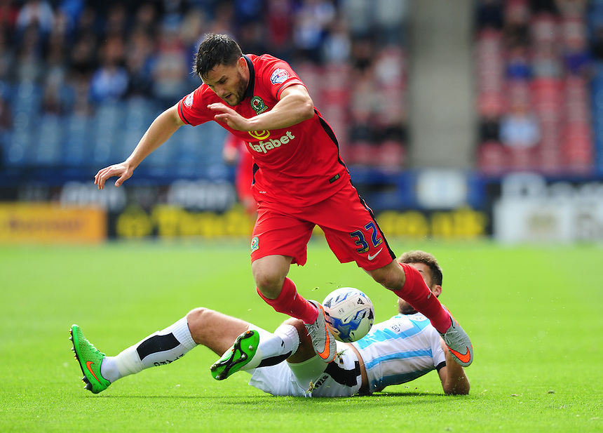 Blackburn Rovers' Craig Conway is fouled by Huddersfield Town's Tommy Smith<br /> <br /> Photographer Chris Vaughan/CameraSport<br /> <br /> Football - The Football League Sky Bet Championship - Huddersfield Town v Blackburn Rovers - Saturday 15th August 2015 - The John Smith's Stadium - Huddersfield<br /> <br /> &copy; CameraSport - 43 Linden Ave. Countesthorpe. Leicester. England. LE8 5PG - Tel: +44 (0) 116 277 4147 - admin@camerasport.com - www.camerasport.com
