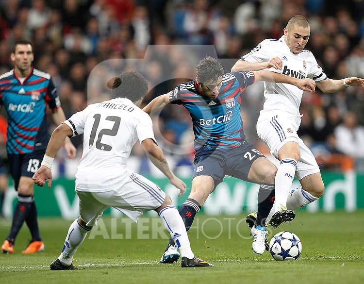 Real Madrid's Karim Benzema and Olimpique Lyon's Christine Nilsen during Champions League match in Madrid on March 16th 2011...Photo: Cid-Fuentes / Cebolla / ALFAQUI