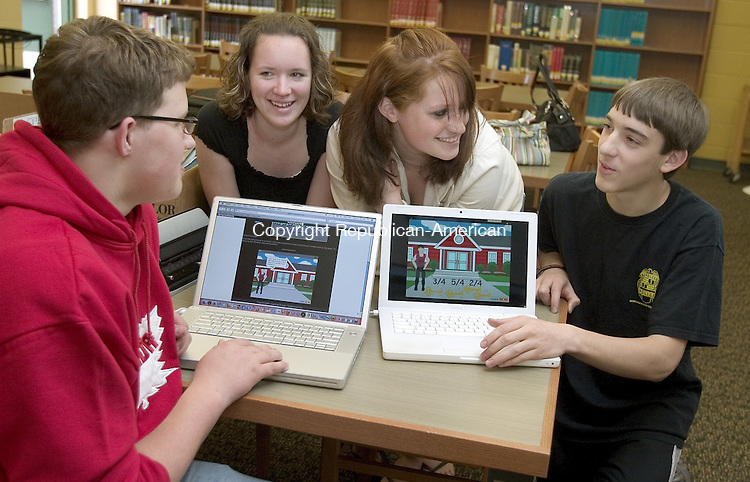 PLYMOUTH, CT. 08 May 2008-050808SV03--From left, Kyle Konopaske, 17, Katy Gudeczauskas, 15, Laura Beck, 15, and Connor Raymond, 16, work with a video game their group created to teach math skills to middle school students at Terryville High School in Plymouth Thursday. The group will present the video game at the Connecticut Convention Center on Saturday.<br /> Steven Valenti Republican-American