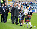 The 2013 / 2014 Championship trophy is piped in to Dens Park.