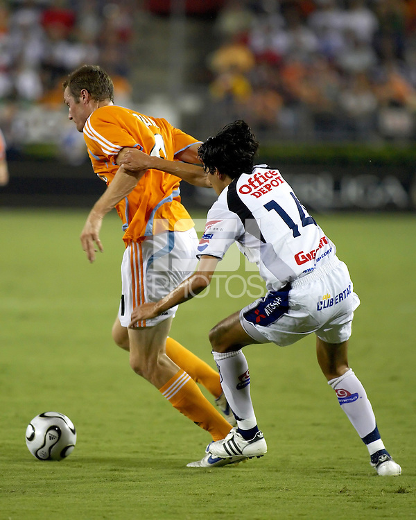 CF Pachuca defender Marvin Cabrera (14) impedes the progress of Houston Dynamo forward Nate Jaqua (21). CF Pachuca defeated Houston Dynamo 4-3 in penalty kicks after a 2-2 tie in regulation and extra time at Robertson Stadium in Houston, TX on August 14, 2007 in the SuperLiga semi-finals.