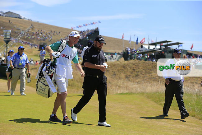 Shane LOWRY (IRL) and caddy Dermot Byrne walk off the 1st tee to start his match during Sunday's Final Round of the 2015 U.S. Open 115th National Championship held at Chambers Bay, Seattle, Washington, USA. 6/21/2015.<br /> Picture: Golffile | Eoin Clarke<br /> <br /> <br /> <br /> <br /> All photo usage must carry mandatory copyright credit (&copy; Golffile | Eoin Clarke)